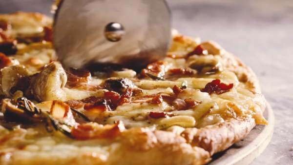 make pizza from scratch in this recipe video dough bacon mushrooms