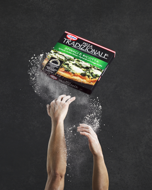 Dr Oetker traditional pizza pizzaiollo pizza maker hands tossing pizza with flour