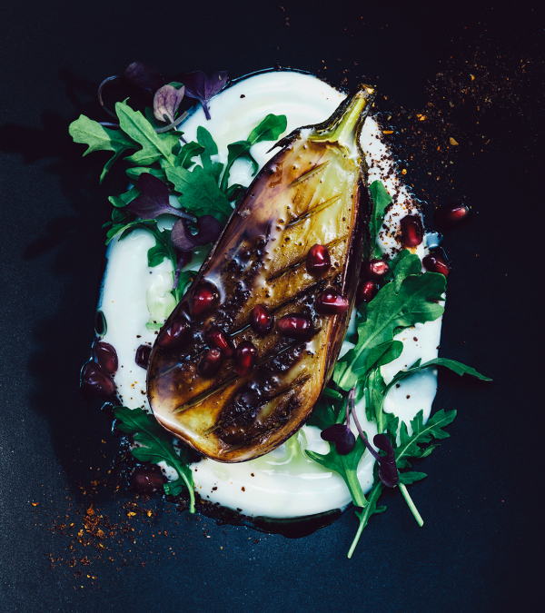 grilled eggplant dish with arugula and pomegranate