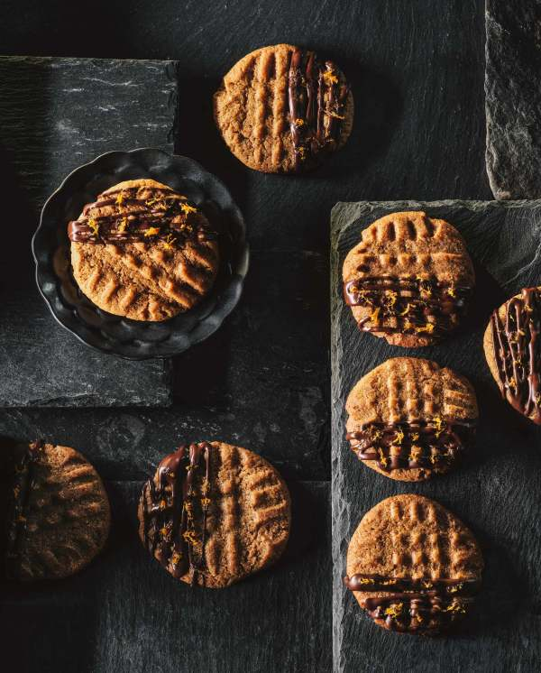miso almond butter cookies on slate drizzled with chocolate