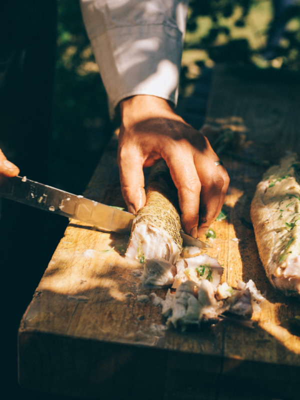 chef cutting and prepping fish