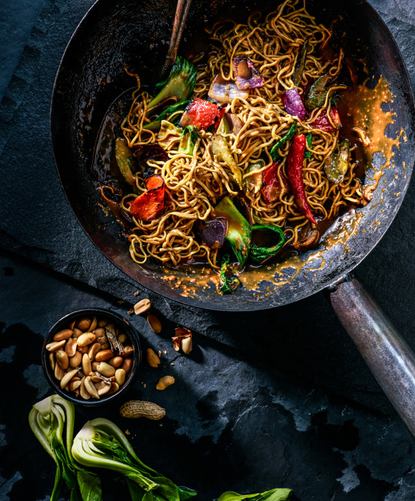 Kung Pao Noodle stir fry with peanuts,  bok choy, chili