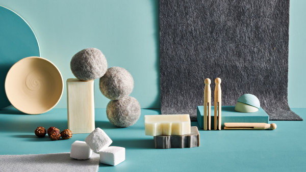 blue and grey still life with felt balls, clothespins, and soap