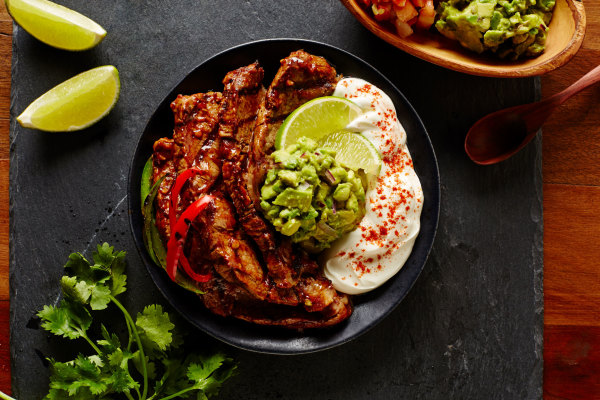 grilled beef with avocado cilantro and creamy garlic sauce