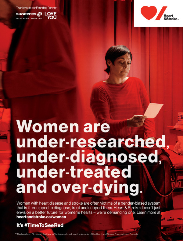 Advertisement for the Heart and Stroke Foundation featuring a woman in a red sweater reading a note in a red lit room