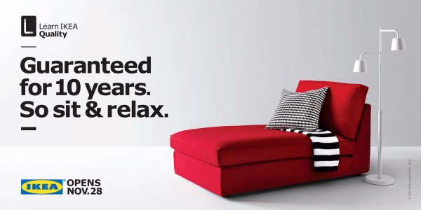 long red couch style chair with black and white striped pillow and scarf from IKEA