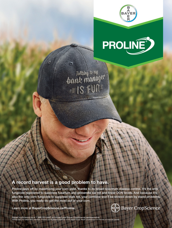 farmer wearing blue ball cap and checkered shirt in front of corn field for Proline