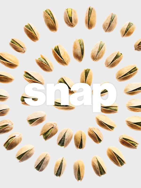 unshelled pistachios arranged in a spiral with words snap on top