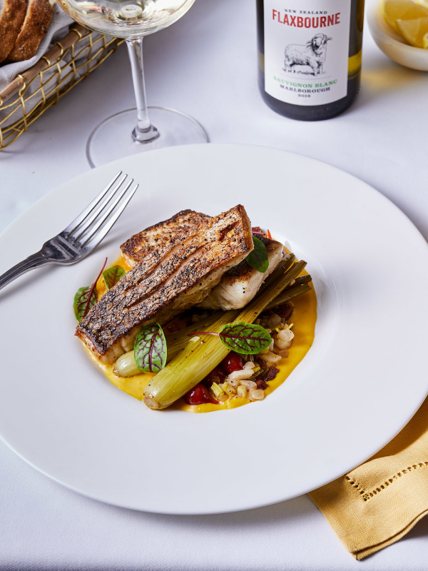 grilled fish on white plate with Flaxbourne wine