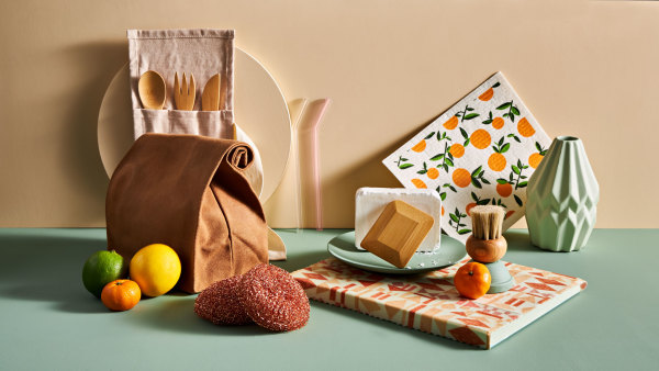 green and beige still life with citrus fruit and lunch bag
